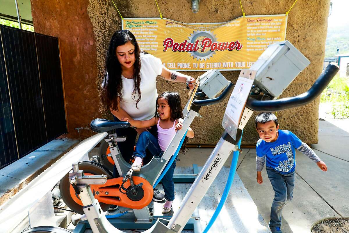(l-r) Mayra Villafania and her children Nancy, 4, and Damian, 7, check out the bicycles at the Solar Living Center in Hopland, California, on Wednesday, May 1, 2019. Flow Kana recently bought the 12-acre property and will invest money into it to make it a visitors center.