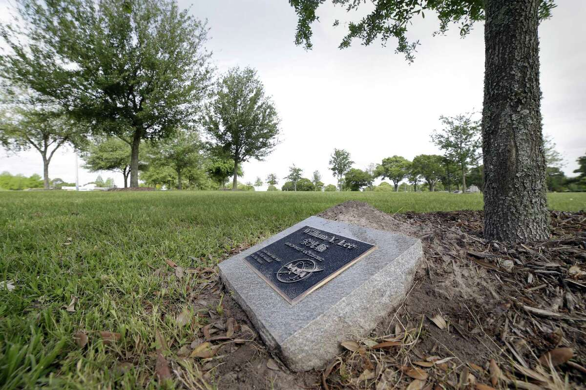 The tree and plaque of NASA employee William Lee rests in the memorial grove at the Johnson Space Center on April 16, 2019 in Houston.