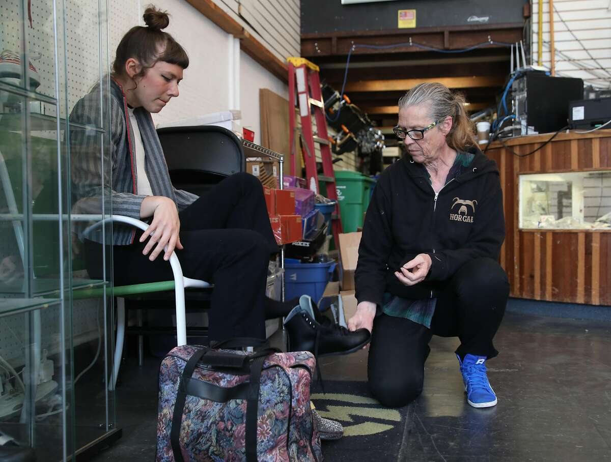 Owner Carol Sloan (right) talks with customer skater girl Gayle Walsworth (left) as she tries on a pair at Skates on Haight on Thursday, April 25, 2019, in San Francisco, Calif. Skates on Haight, a 45-year-old skate shop in the Haight, is looking for a co-tenant to share their space because of the rising cost of rent.