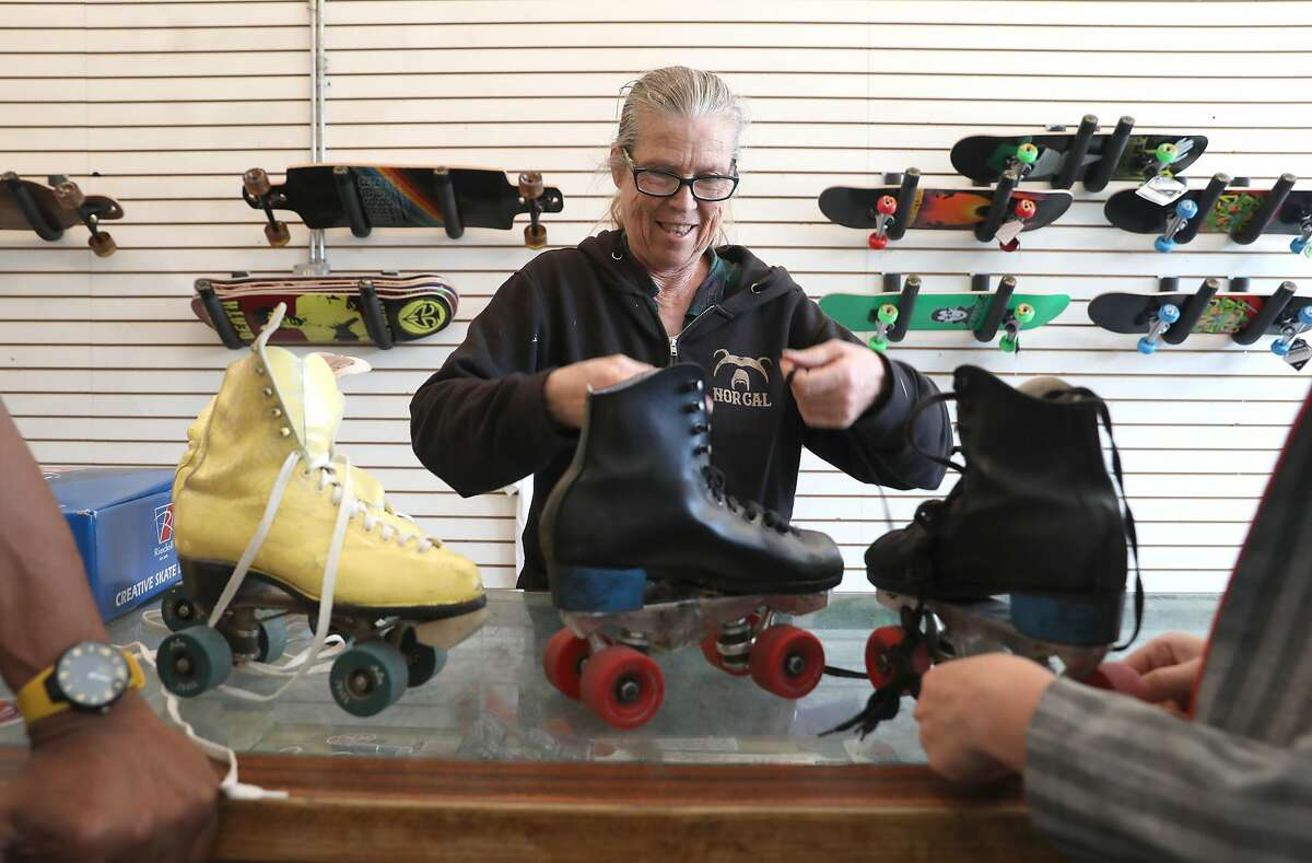 Owner Carol Sloan strings some skates at Skates on Haight on Thursday, April 25, 2019, in San Francisco, Calif. Skates on Haight, a 45-year-old skate shop in the Haight, is looking for a co-tenant to share their space because of the rising cost of rent.