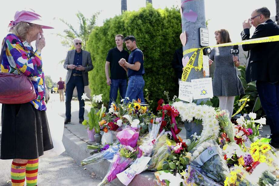 Mourners and well wishers leave flowers at a make-shift memorial across the street from the Chabad of Poway Synagogue on April 28, in Poway, California, one day after a teenage gunman opened fire, killing one person and injuring three others. A reader appreciates the care local authorities are taking to ensure the safety of the community after the recent attacks. Photo: SANDY HUFFAKER /AFP /Getty Images / AFP or licensors