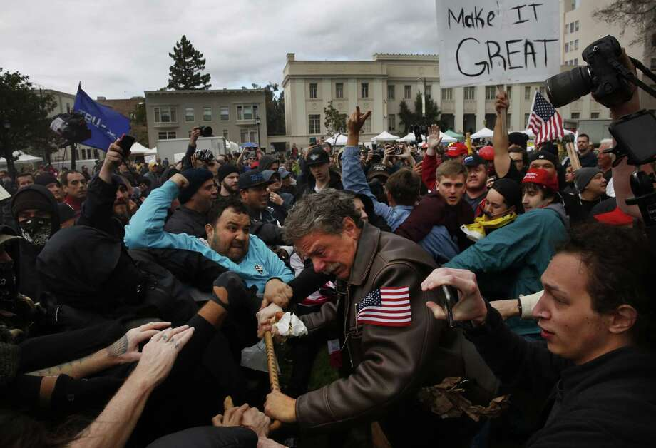 Tom Condon of San Francisco, center, a Trump supporter, becomes entangled in the center of a fight after attempting to push protesters back with his cane during a Pro-President Donald Trump rally and march at the Martin Luther King Jr. Civic Center park March 4, 2017 in Berkeley, Calif. It seems the ability to have civilized conversations about opposing views has dwindled. Photo: Leah Millis /The Chronicle / Leah Millis/ The Chronicle