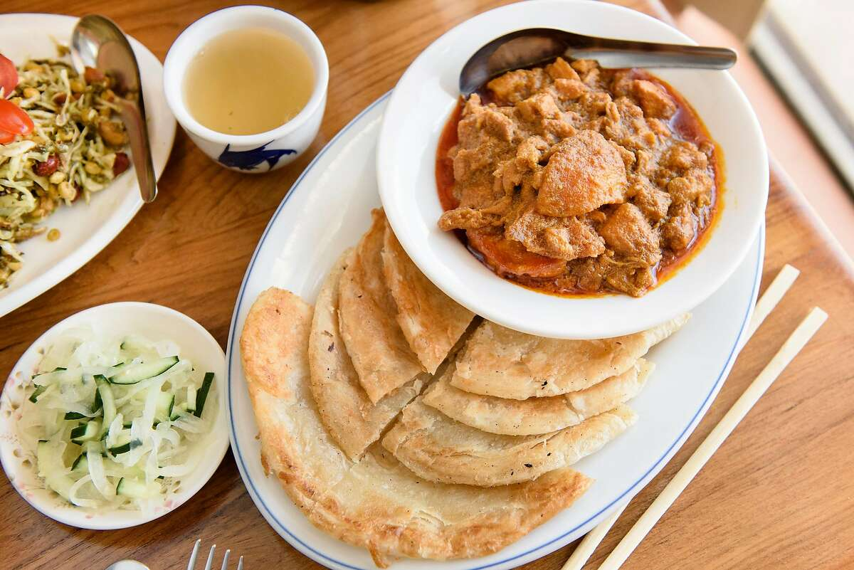 The chicken curry with paratha bread at Kyain Kyain restaurant in Fremont, Calif, on Saturday, April 20, 2019.