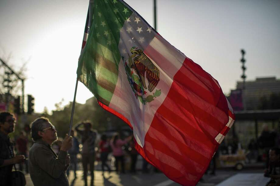 A marcher carries a U.S. flag and a flag of Mexico on May Day in Los Angeles. A reader says immigrants are important to America and should be treated fairly. Photo: David McNew /Getty Images / 2019 Getty Images
