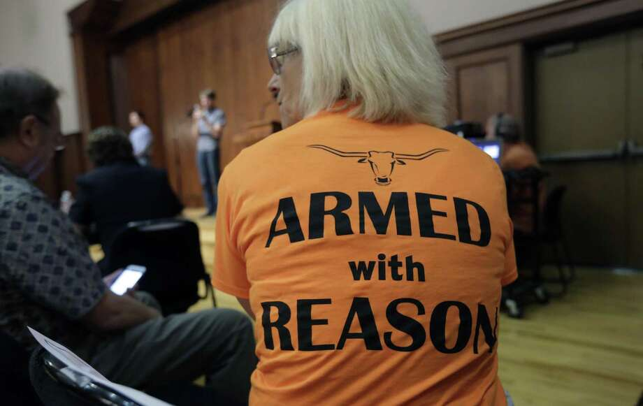 Professor Ann Cvetkovich waits to speak during a public forum at the University of Texas campus as a special committee studies how to implement a new law allowing students with concealed weapons permits to carry firearms into class and other campus buildings, Wednesday, Sept. 30, 2015, in Austin, Texas. The law takes effect in August 2016. (AP Photo/Eric Gay) Photo: Associated Press File Photo / AP