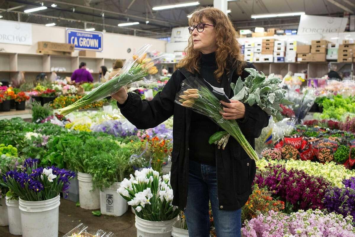 Florist Laurel Ann Winzler shops at the San Francisco Flower Mart, for flowers she uses in her florist business. Friday, April 26, 2019. San Francisco, Calif.