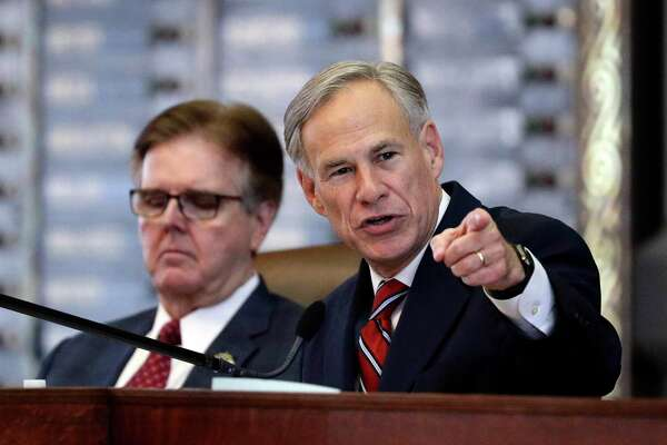 FILE - In this Feb. 5, 2019 file photo, Texas Gov. Greg Abbott, right, gives his State of the State address as Lt. Gov. Dan Patrick, left, listens in the House Chamber in Austin, Texas. (AP Photo/Eric Gay, File)