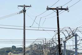 High voltage power lines extend overhead from a PG&E substation on Ygnacio Valley Road in Concord, Calif. on Friday, May 3, 2019.