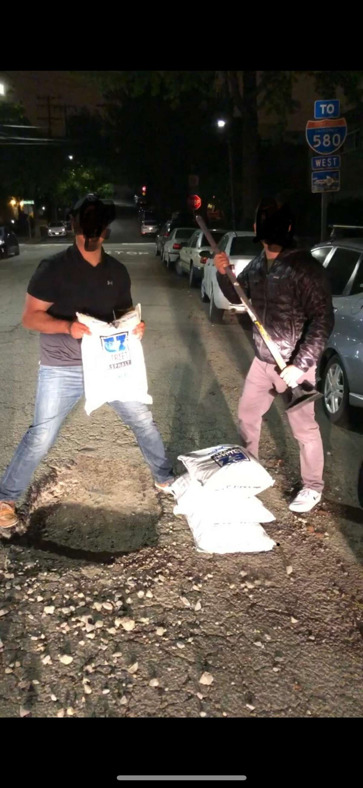 """The """"Pothole Vigilantes"""" shared photos of potholes they've patched up in Oakland in recent weeks. They edited this photo before sharing to obscure identities."""