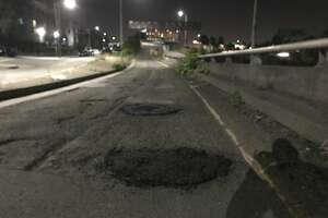 """The """"Pothole Vigilantes"""" shared photos of potholes they've patched up in Oakland in recent weeks."""