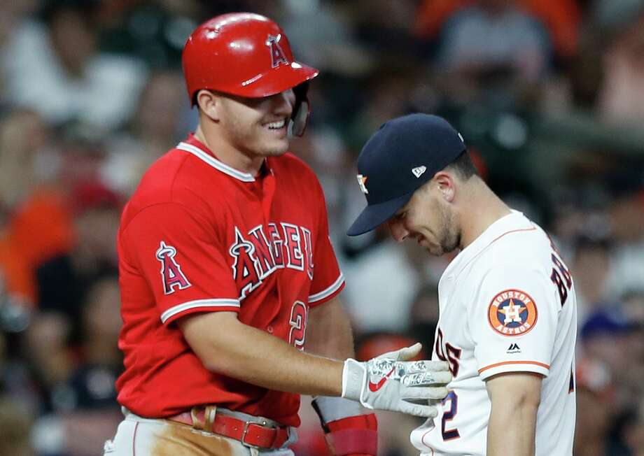 The Angels' Mike Trout, left, and Astros'Alex Bregman, both top-five finishers in last year's American League MVP race, chat at third base during a 2018 game at Minute Maid Park. Photo: Karen Warren, Staff / Houston Chronicle / © 2018 Houston Chronicle