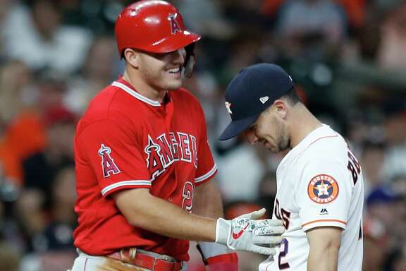 Mike Trout, left, won the AL's MVP award for the third time in the last six seasons, while Alex Bregman went from fifth place in the 2018 voting to second this year.