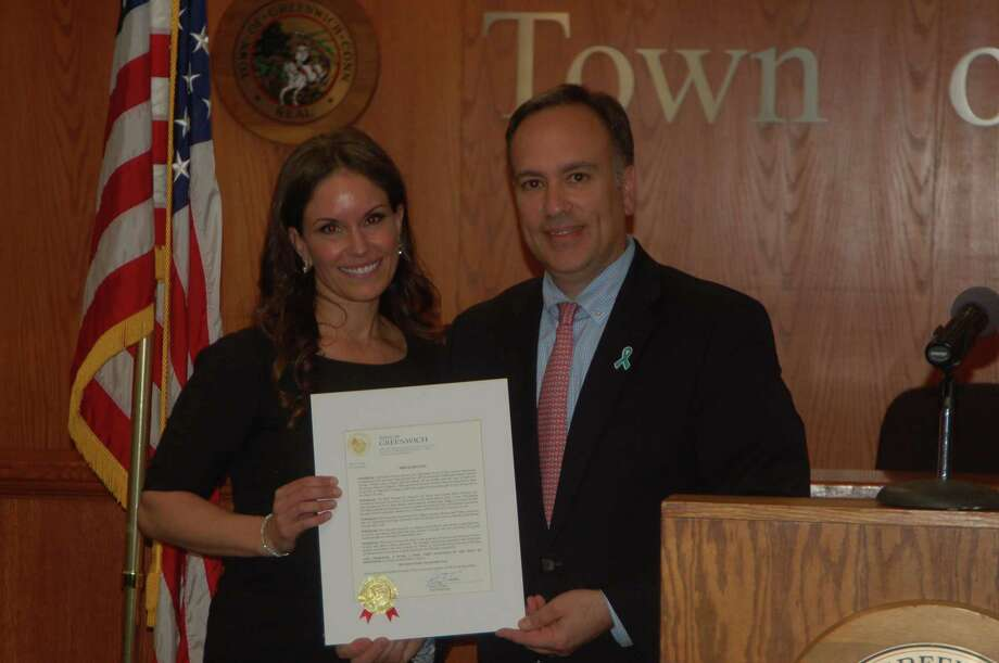 Kaile Zagger is one of the co-founders of the MAT Program as a tribute to her late mother, Mailyn Ann Trahan, who was diagnosed too late with ovarian cancer. By doing more to educate medical professionals about the vague symptoms, the goal is to catch it much earlier. First Selectman Peter Tesei presents her with a proclamation on May 1 at Town Hall. Photo: Ken Borsuk / Hearst Connecticut Media /