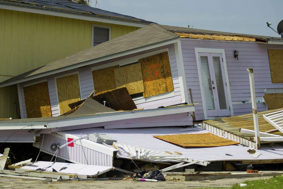 A destroyed house leans against its neighbor in Rockport, TX, Wednesday, Sept. 13, 2017. Rockport took a direct hit from Hurricane Harvey on August 25, 2017. (Mark Mulligan / Houston Chronicle)