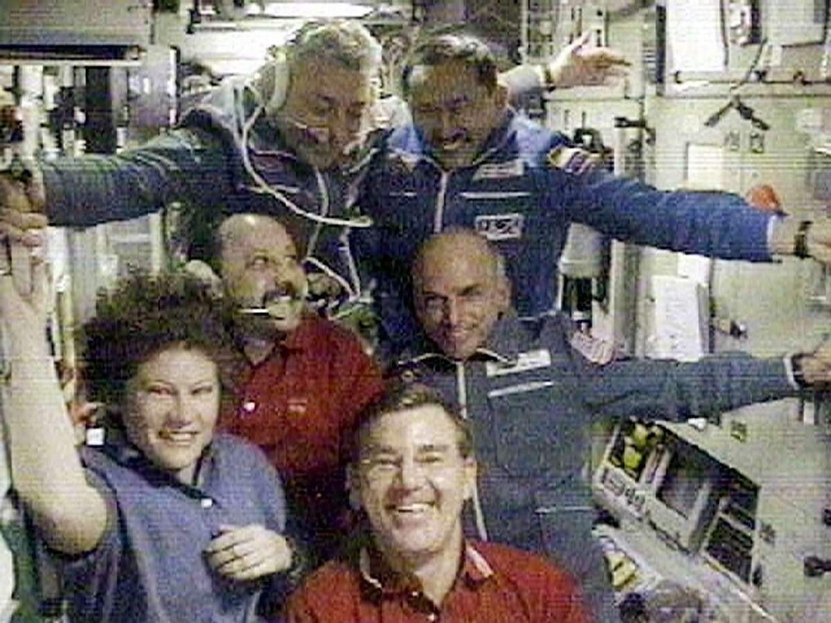 California millionaire Dennis Tito poses with the International Space Station crew shortly after his arrival to the station, in this image from television on April 30, 2001. Shown clockwise from bottom left are: U.S. astronaut Susan Helms, Russian cosmonauts Yuri Usachev, Yuri Baturin and Talgat Musabayev, U.S. space tourist Dennis Tito, and U.S. astronaut Jim Voss.