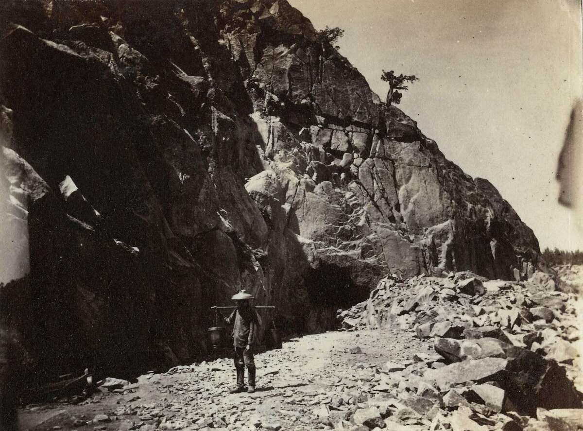 A Chinese immigrant laborer is depicted in an undated photo at the site of a tunnel under excavation as part of the construction of the Transcontinental Railroad.
