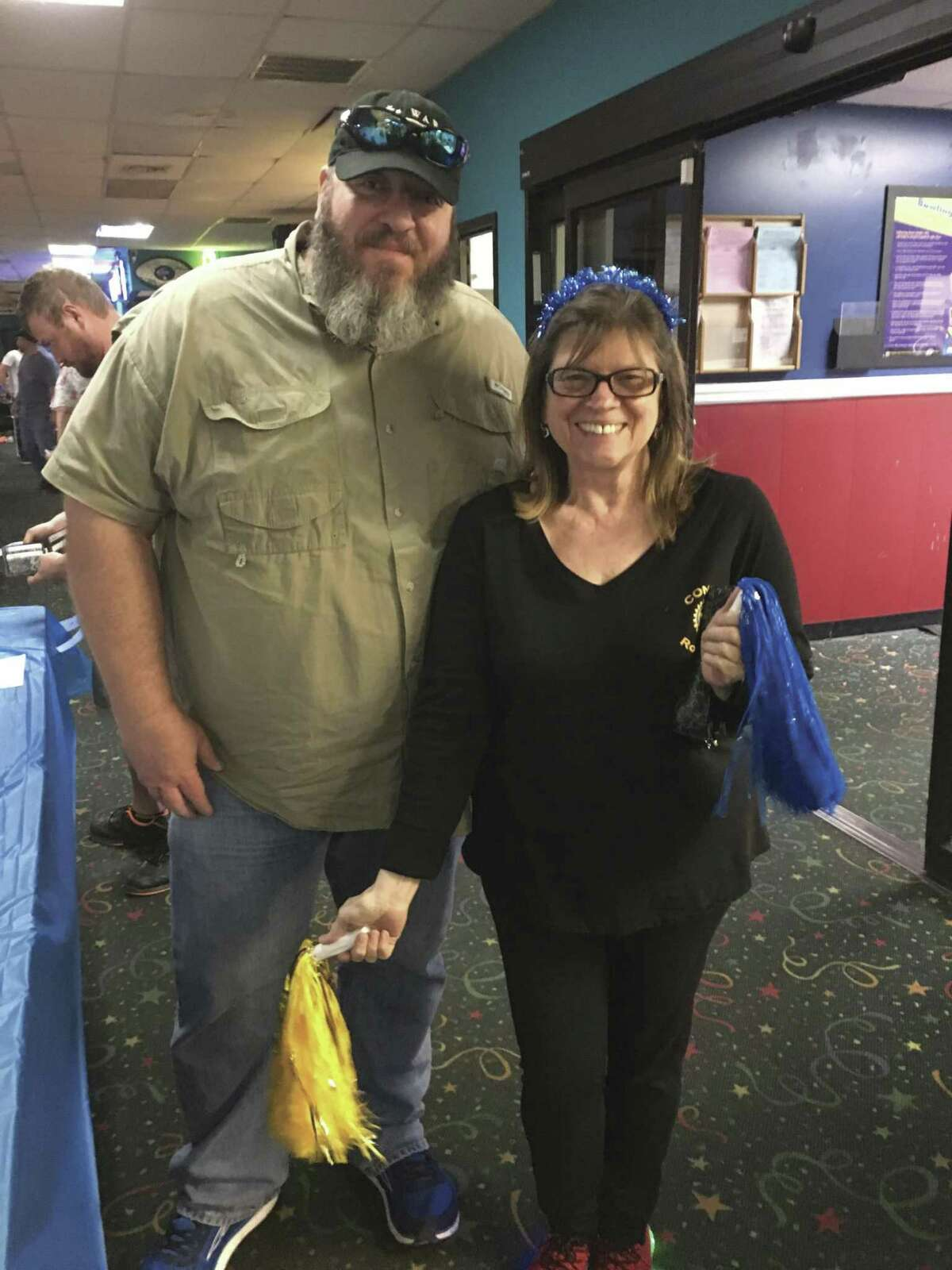 Rotary Club of Conroe members Chris Sadler, left, and Kris Nordstrom McBride, are pictured at the club's First 5th Tuesday Bowling Night Tuesday night at 300 Bowl in Conroe.