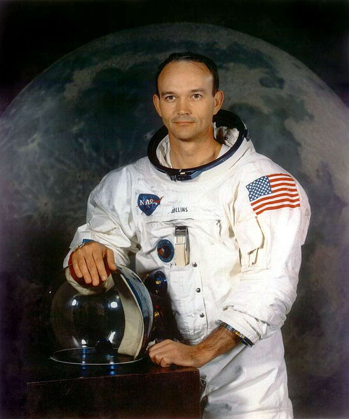 A handout portrait taken in July 1969 shows astronaut Michael Collins, command module pilot of the Apollo 11 moon landing mission. Collins orbited the moon while Neil Armstrong and Buzz Aldrin walked on the lunar surface for the first time.