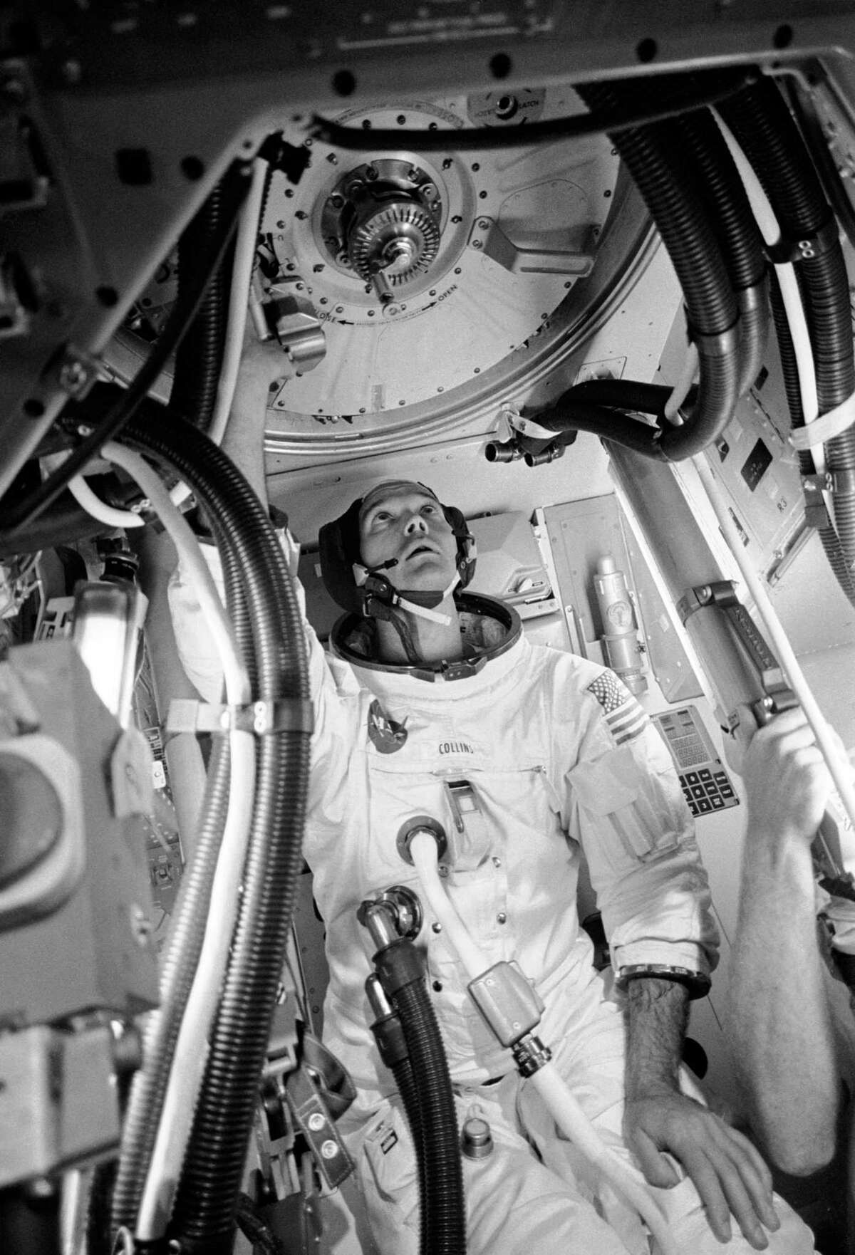 In this June 28, 1969 photo, astronaut Michael Collins is shown inside an Apollo Command Module mockup practicing procedures with the docking mechanism in preparation for the scheduled Apollo 11 lunar landing mission. Collins was command module pilot of the Apollo 11.