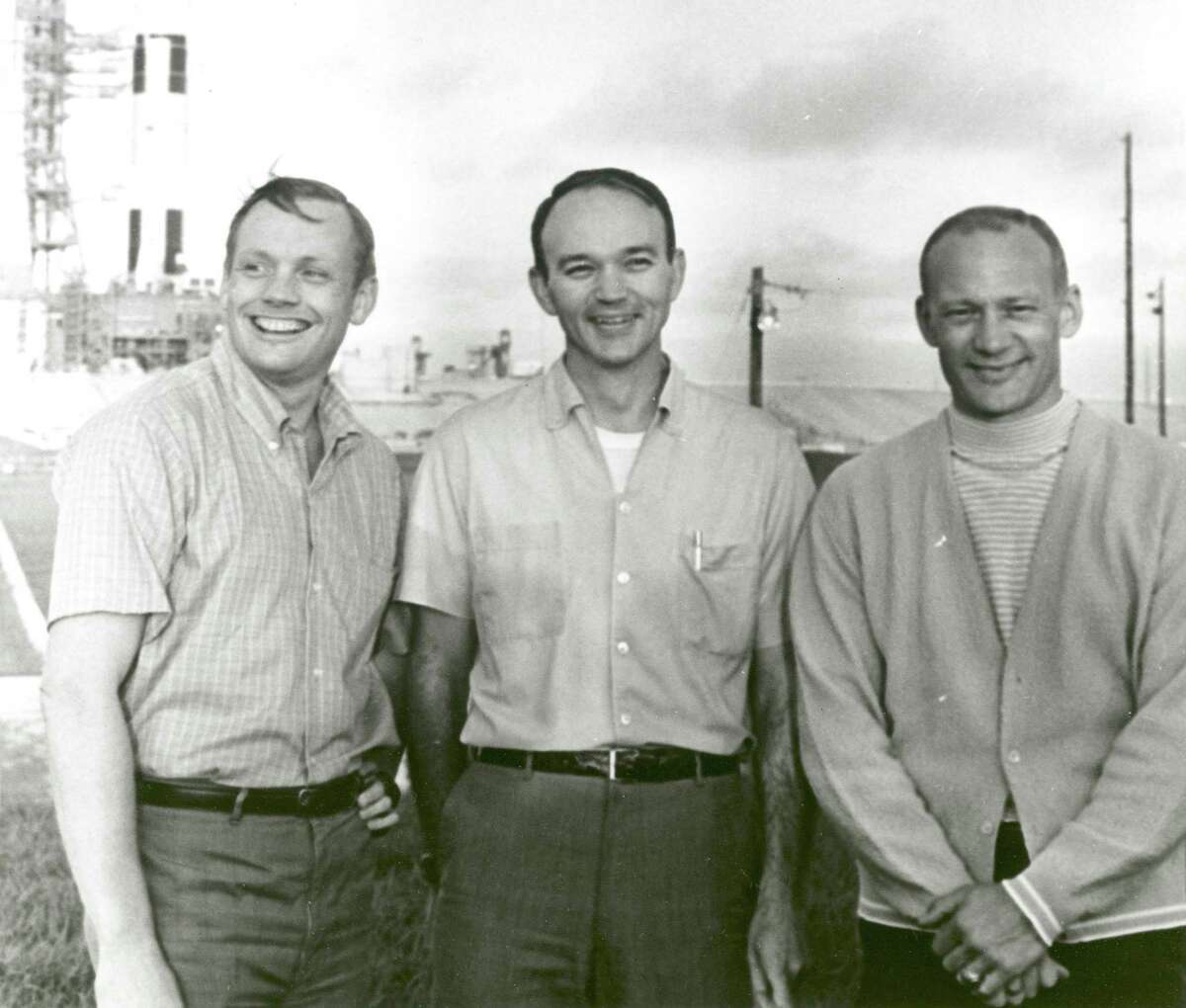 In this July 16,1969, NASA's Apollo 11 flight crew - from left, Neil Armstrong, commander; Michael Collins, command module pilot; and Buzz Aldrin, lunar module pilot - stand near the Apollo/Saturn V space vehicle that would eventually carry them into space.