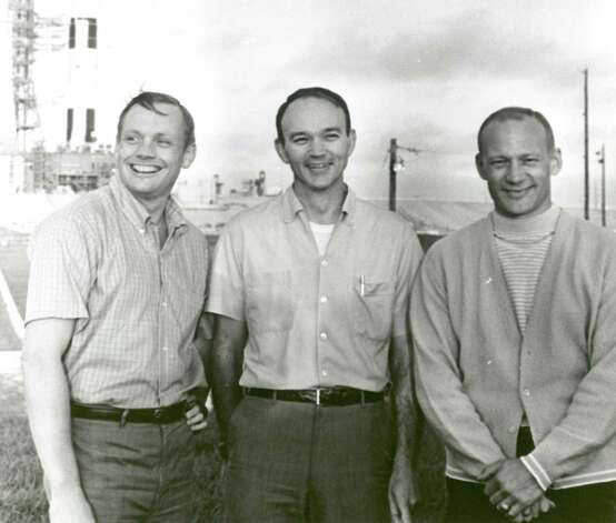 In this July 16,1969, NASA's Apollo 11 flight crew — from left, Neil Armstrong, commander; Michael Collins, command module pilot; and Buzz Aldrin, lunar module pilot — stand near the Apollo/Saturn V space vehicle that would eventually carry them into space. Photo: NASA / MCT