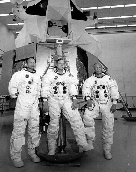 "Apollo 11 astronauts Mike Collins (left), Neil Armstrong (center), and ""Buzz"" Aldrin stand in front of the Lunar Landing Module Simulator at the Kennedy Space Center prior to their 1060 mission to the moon. Photo: Central Press, Stringer / Getty Images / Hulton Archive"
