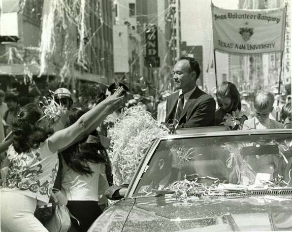 08/16/1969 - Apollo 11 astronaut Michael Collins receives cheers from the crowds during a ticker-tape parade in downtown Houston on Aug. 16, 1969 after the astronauts returned from their lunar mission. Photo: Jerry Click, HP Staff / Houston Chronicle / © Houston Chronicle
