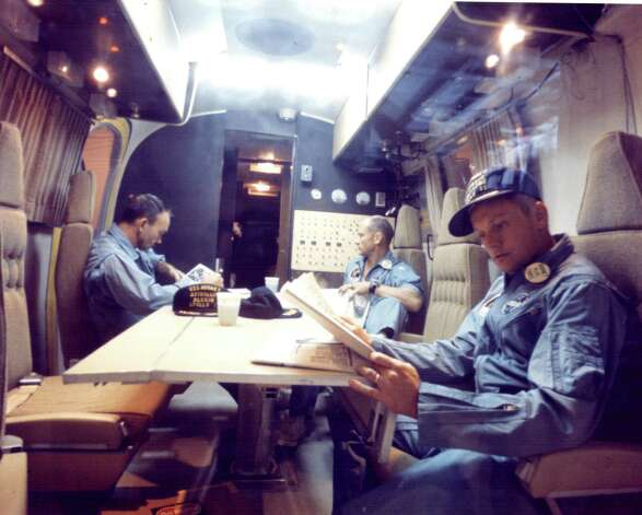 In this 1969 file photo, Apollo 11 astronauts (from left) Michael Collins, Buzz Aldrin and Neil Armstrong are shown in the Mobile Quarantine Facility, relaxing after their successful lunar landing mission. They spent two-and-one-half days in the quarantine trailer en route from the USS Hornet, the prime recovery ship, to the Lunar Receiving Laboratory at what was then known as the Manned Spacecraft Center in Houston. Photo: NASA / handout