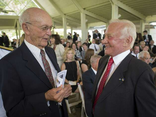 Apollo 11 Astronauts Michael Collins, left, and Buzz Aldrin talk at a private memorial service celebrating the life of Neil Armstrong on Aug. 31, 2012, in Cincinnati. Photo: NASA, Project Mgr./Sr. Photographer / (NASA/Bill Ingalls) / (NASA/Bill Ingalls)