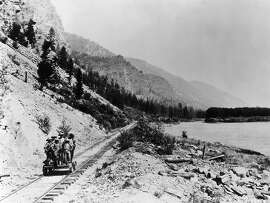 (Original Caption) Chinese coolie labor on the Northwest Pacific Railway in the 1880s. Due to the scarcity of labor following the U.S. Civil War, it was necessary to import 15,000 Chinese to help build the first northern transcontinental line. Shows Chinese laborers on a hand-car. Photograph
