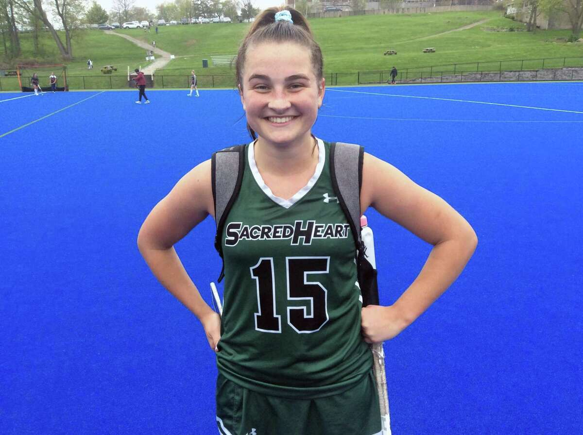 Sacred Heart Greenwich junior Morgan Smith scored five goals in the Tigers' 18-7 win over visiting Greens Farms Academy on Friday in Greenwich.