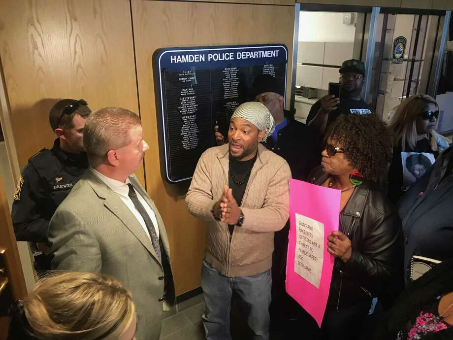 Remidy Shareef, center, and Barbara Fair, right, surrounded by protesters talk with Hamden Deputy Police Chief Bo Kicak inside the police department Tuesday April 16, 2019 about the police involved shooting of a young woman and man pursued into New Haven earlier that morning. Photo: Clare Dignan / Hearst Connecticut Media /