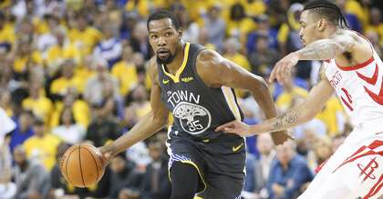 606b9d120949 Golden State Warriors forward Kevin Durant (35) drives the ball past  Houston Rockets guard Gerald Green (14) in game 2 of the NBA Western  Conference ...