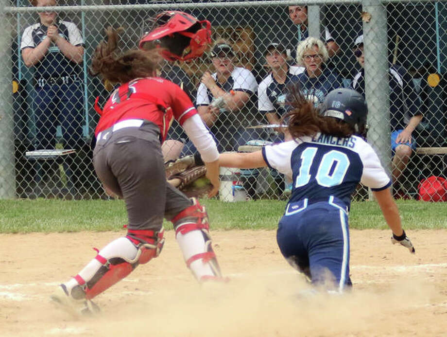 Belleville East's Taylor Sparks (10) runs into Alton catcher Audrey Evola, who loses her catcher's mask but keeps the ball in her glove after tagging out Sparks in the second inning Friday at Rita Menke Field in Belleville. Photo: Greg Shashack / The Telegraph