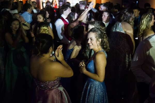 Freeland High School students enjoy their prom at the Great Hall Banquet & Convention Center on Friday, May 3, 2019. (Katy Kildee/kkildee@mdn.net))