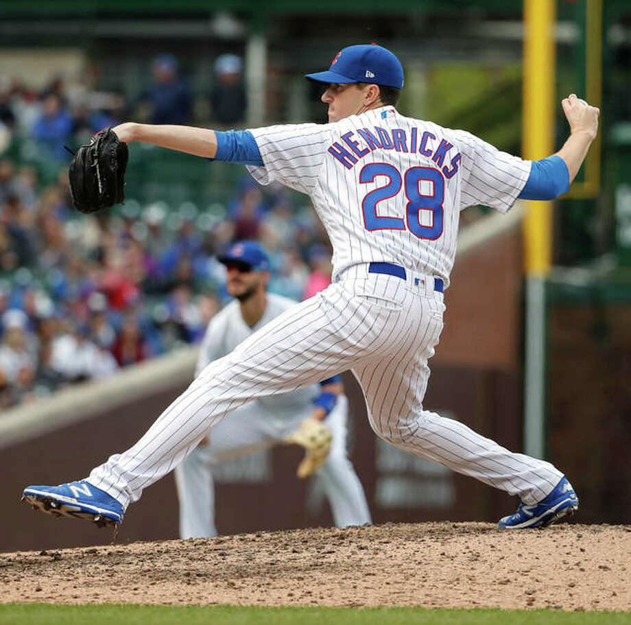 Cubs pitcher Kyle Hendricks delivers against the Cardinals in his shutout Friday at Wrigley Field in Chicago. Photo: Associated Press