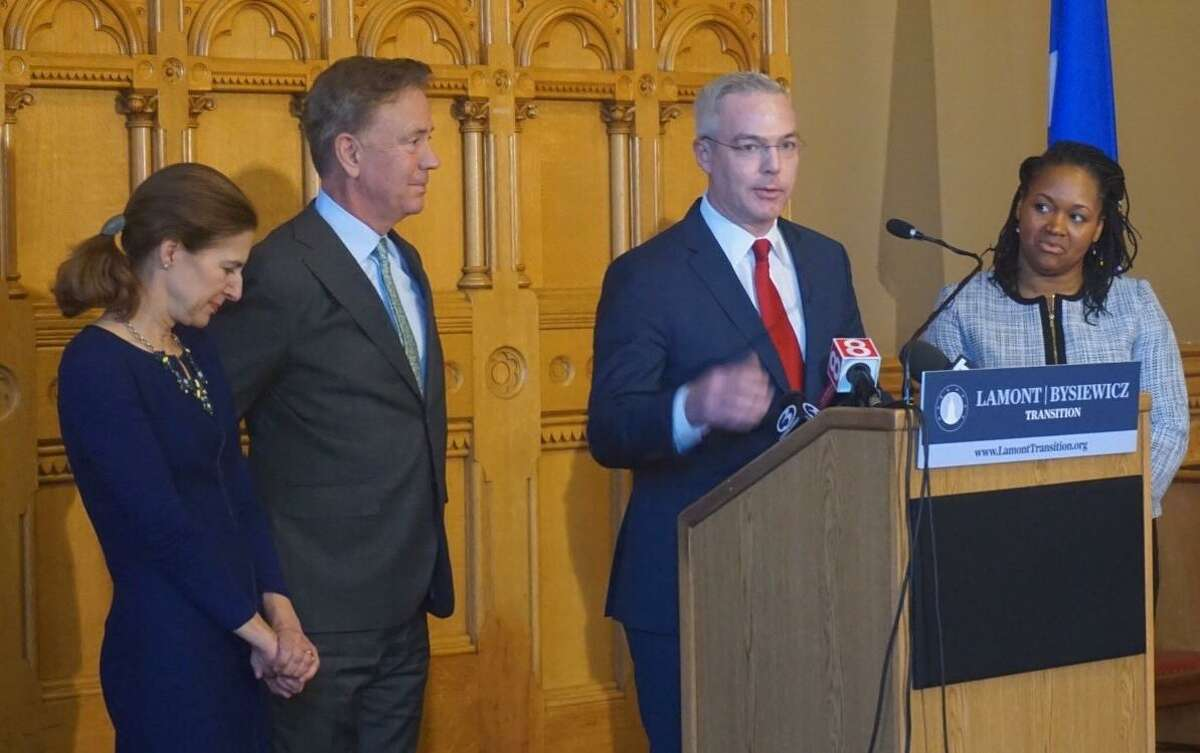 Ryan Drajewicz, at the podium, and Melissa McCaw, at right, were named chief of staff and secretary of the Office of Management and Budget, respectively, by Gov.-Elect Ned Lamont on Tuesday, Dec. 4, 2018. At left are Lamont and Lt. Gov-elect Susan Bysiewicz.