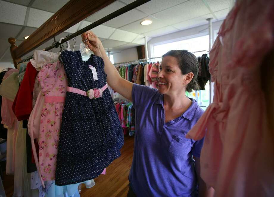 Tamar Klein, owner of I Spy Consignment at 415 Main Street in Monroe, specializes in children's items, like clothing and strollers. Photo: Brian A. Pounds / Connecticut Post
