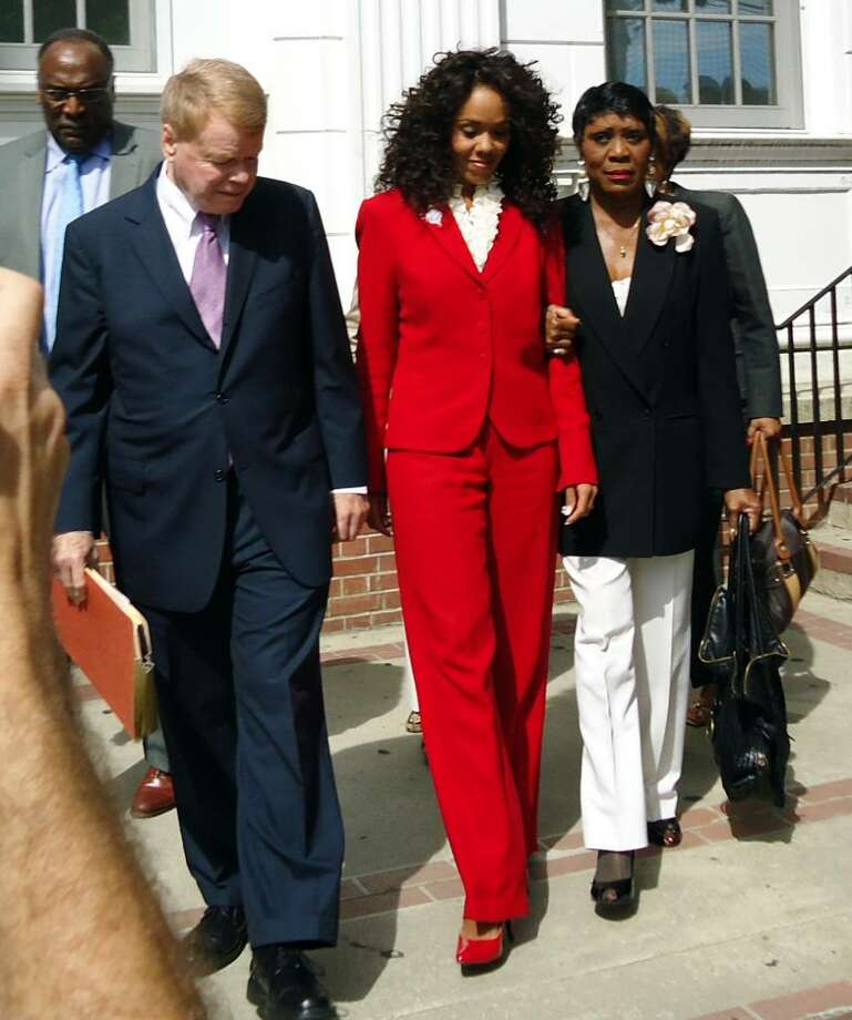 Desiree Fontaine leaves Milford Superior Court with attorney Hugh Keefe and Carroll Brown, President of the West Haven Black Coilition Tuesday, July 27th, 2010. Shoplifting charges against Fontaine were dropped today after her attorney said she completed community service. Photo: Michael P. Mayko / Connecticut Post