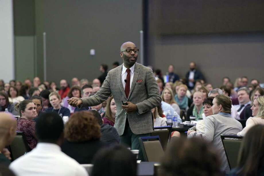 Christopher Emdin delivers the keynote address at the local Urban Schools Conference on Tuesday, Nov. 7, 2017, in Albany, N.Y. Schenectady City School District and Capital Region BOCES teamed up to offer the first-ever local Urban Schools Conference at the Albany Capital Center. (Paul Buckowski / Times Union) Photo: Jerry Lara / Albany Times Union / 20042063A