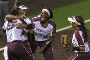 Summer Creek's Dani Moreno (55), Tauryn Cummings (15) and others celebrate after defeating Dawson 8-6 in an area round high school softball playoff game at Humble High School on Friday, May 3, 2019, in Humble, Texas.