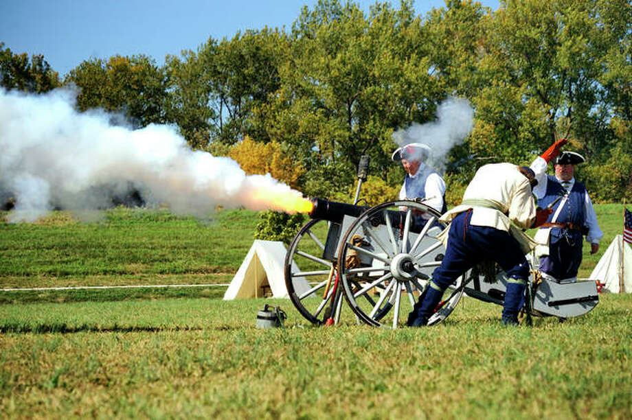 Reenactors fire a cannon during a previous Point of Departure Weekend at the Lewis and Clark State Historic Site in Hartford. This year's event, marking the 215th anniversary of the departure of the Lewis and Clark Expedition, is May 11-12. Photo: For The Telegraph