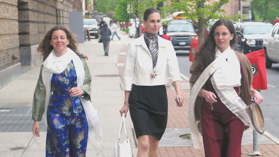 Sara Bronfman, left, NXIVM insider Pamela Cafritz, center, and Clare Bronfman, right, exit the Palace Theater in Albany, N.Y., following a presentation by the Dalai Lama May 6, 2009. Clare Bronfman pleaded guilty to criminal charges. Cafritz died in 2016 and prosecutors say Raniere continued to use her credit cards. Sara Bronfman has not been charged. (Patrick Dodson / Special to the Times Union)