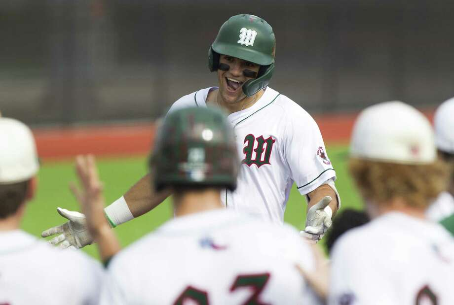 Luke Hammond #8 of The Woodlands reacts after hitting his second solo home run of the game during the fourth inning of a Region II-6A bi-district high school baseball playoff game at Grand Oaks High School, Saturday, May 4, 2019, in Spring. Photo: Jason Fochtman, Houston Chronicle / Staff Photographer / © 2019 Houston Chronicle