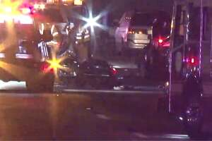 A screenshot of Metro Video footage of a major vehicle crash near South Post Oak Road and South Main Street in Houston, Texas. Around midnight Saturday, several cars spun out of control near the intersection. One motorcyclist was reported to be in critical condition after the crash.