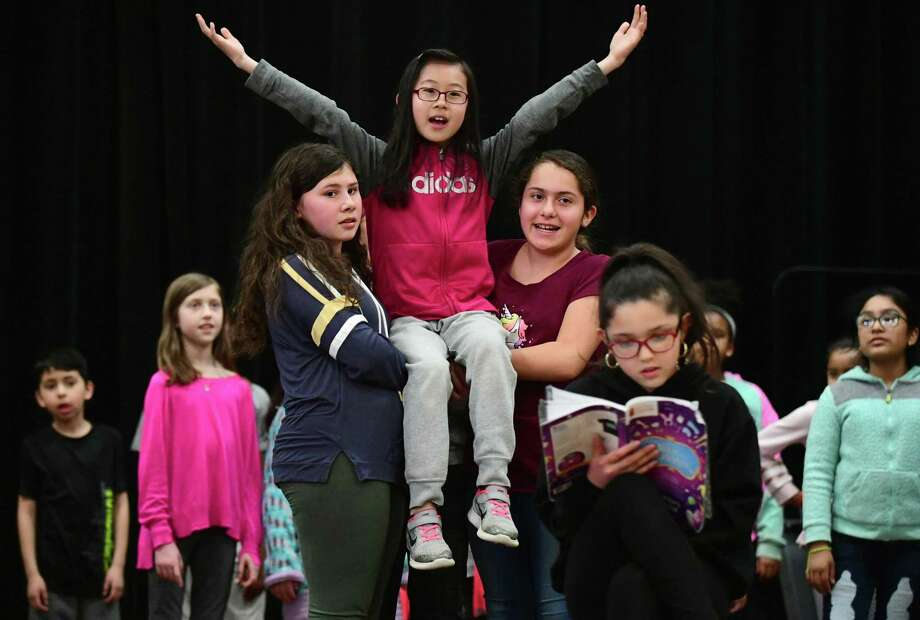 Sophia Chen plays Alice in the rehearsal for the Brookside Elementary School annual production, Alice in Wonderland Junior. Photo: Erik Trautmann / Hearst Connecticut Media / Norwalk Hour