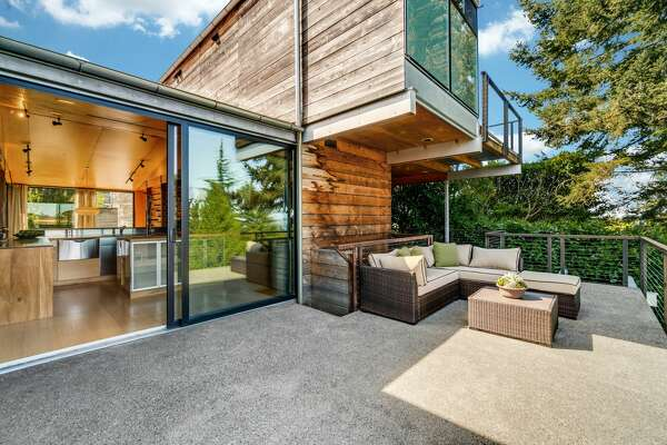 Custom designed contemporary with Sound and mountain views asks $1.35M.