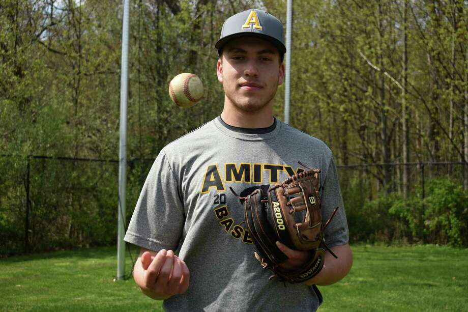 John Lumpinski is the latest in a long line of aces for the Amity baseball team. Photo: Pete Paguaga / Hearst Connecticut Media