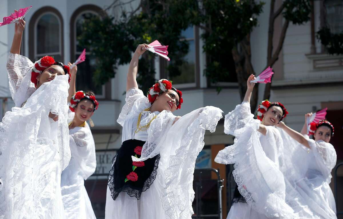 Dancers with the Cathedral City High School Ballet Folklorico group from Riverside County perform on stage at the Cinco de Mayo festival on Valencia Street in San Francisco, Calif. on Saturday, May 4, 2019.