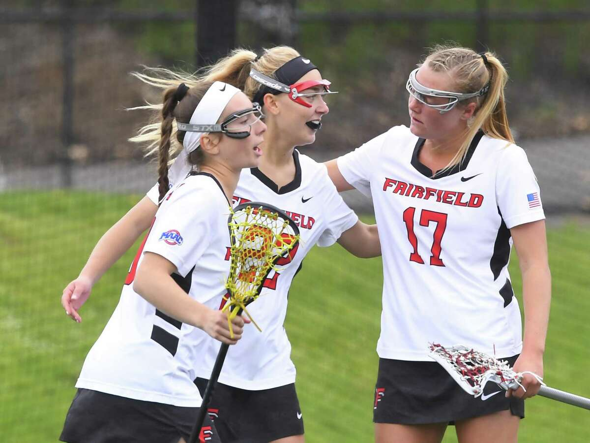 Kelly Horning (17) and the Fairfield women's lacrosse team celebrate during their win in the MAAC championship game on Saturday.